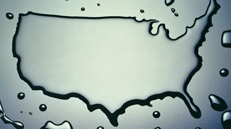 USA in Water: The Shape of the USA is Outlined with Water on a Plain Blue-Grey Background